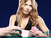 Woman doubt in a card gambling match — Stock Photo