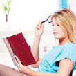 Woman reading book at home — Stock Photo