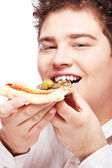 Chubby boy eating a slice of pizza — Foto de Stock
