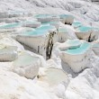 Stock Photo: Blue water travertine pools at Pamukkale, Turkey