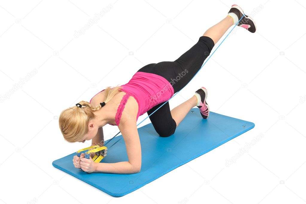 Female lying abs crunching exercise with fitness ball ...
