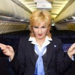Stock Photo: Air hostess gesturing