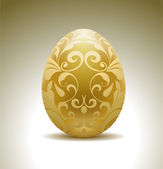 Golden egg with floral decoration. — Stock Vector
