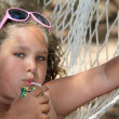 Girl drinking juice in the hammock — Stock Photo