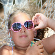 Royalty-Free Stock Photo: Girl with glasses in the hammock