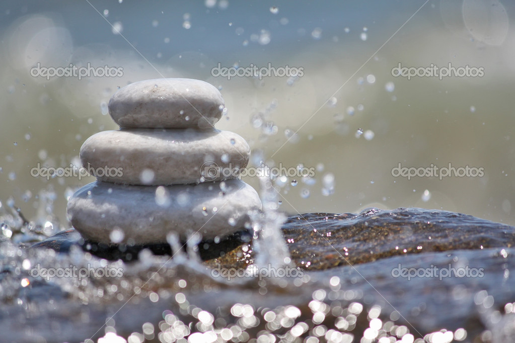 White stones in the water — Stock Photo #9186759