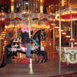 Girl on the carousel - Stock Photo