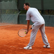 Stock Photo: Man playing tennis