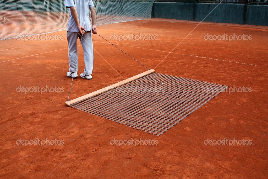 Cleaning tennis court  Stock Photo #9335405