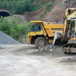 Stock Photo: Trucks in open pit
