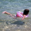 Stock Photo: Girl with pink belt in the sea