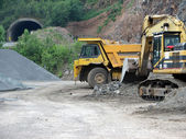 Trucks in the open pit — Stock Photo
