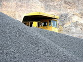 Truck in the open pit — Stock Photo