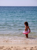 Girl with pink belt in the sea — Stock Photo