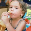 Little girl drink juice with ice — Stock Photo