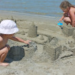 Children with sand castle — Stock Photo