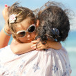 Mother and daughter on the beach — Foto de Stock