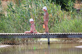 Children in the swamp — Stock Photo