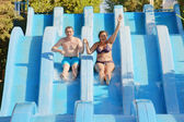 Man and woman in water park — Stock Photo