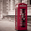 Red telephone near Big Ben - Stock Photo