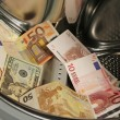 Stock Photo: Money in washing machine