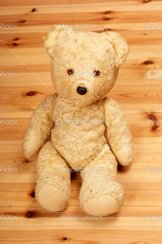 Old teddy bear on the floor — Stock Photo #10524060