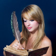 Girl writing in old book — Foto de Stock