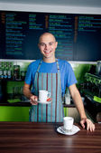 Bartender holding coffee cup — Stock Photo