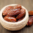 Delicious dates in small bowl — Stock fotografie