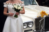 Bride by the car — Stock Photo