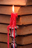 Red burning candle — Stock fotografie