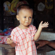 Stock Photo: Young child with funny face in Bagan, Myanmar