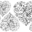 Decorated hearts with flowers — Imagen vectorial