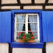 Blue window in country old-style cottage — Stock Photo