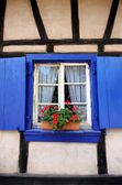 Blue window in country old-style cottage — ストック写真