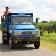 Myanmar old blue truck with workers — Stock Photo