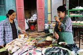 Myanmar woman weighing meat to sell — Foto de Stock