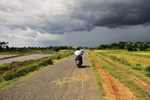 Myanmar landscape with a small road before the storm — Stock Photo
