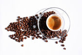Plastic cup with espresso and coffee beans for break time at office — Stock Photo