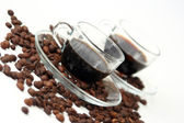 Coffee cups with coffee beans — Stock Photo