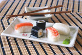 Sushi plate on bamboo tablecloth — Stock Photo