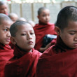 Stock Photo: Novice monks waiting in line, Myanmar