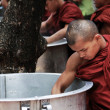 Monk taking rice from a big pan, myanmar — Stock Photo