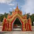 Red gate in Kuthodaw Paya in Mandalay, Myanmar — Stock Photo