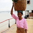 Myanmar woman carrying a basket on her head — Stock Photo