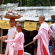 Stock Photo: Three nuns walking in Pakokku