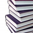Royalty-Free Stock Photo: Stack of purple books on white background