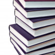 Stack of purple books on white background — Stock Photo #7971142