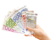 Money on hands — Stockfoto
