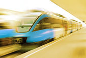 Modern speed train on a station — Stockfoto